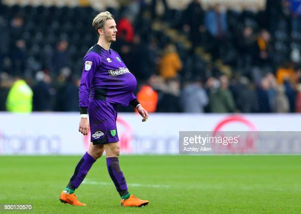 Hattrick scorer James Maddison of Norwich City leaves the field with the match ball during the Sky Bet Championship match between Hull City and...