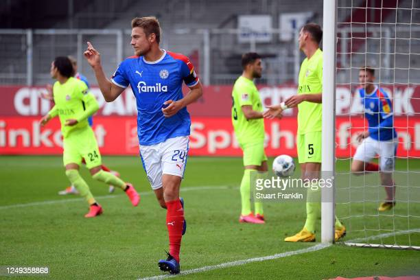 Hauke Wahl of Holstein Kiel celebrates scoring the opening goal during the Second Bundesliga match between Holstein Kiel and SV Wehen Wiesbaden at...