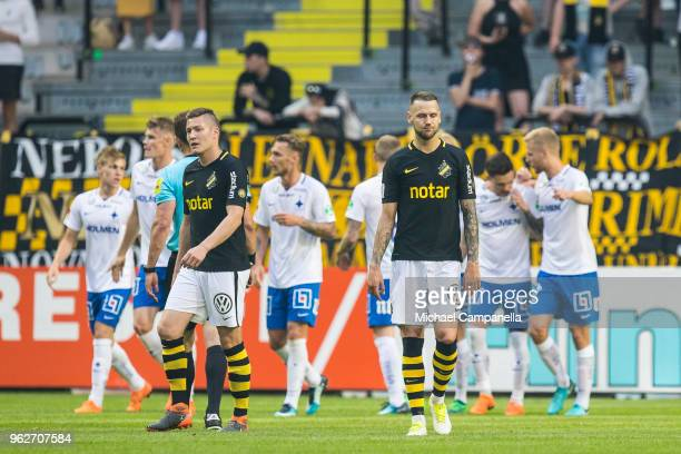 Haukur Hauksson and Alexander Milosevic of AIK are dejected after IFK Norrkoping's David Moberg Karlsson scores the 32 goal during an Allsvenskan...