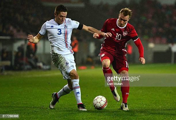 Haukur Heidar Hauksson of Iceland battles for the ball with Christian Eriksen of Denmark during the International Friendly match between Denmark and...
