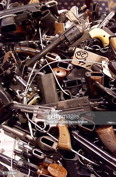 Haul of confiscated guns displayed by the mayor at a City Hall news conference The illegal weapons are slated to be melted down The NYPD's allout war...