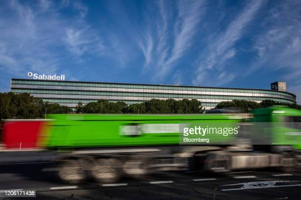 A haulage truck drives past the headquarters of Banco de Sabadell SA in Barcelona Spain on Thursday March 5 2020 Spanish bank shares soared after the...
