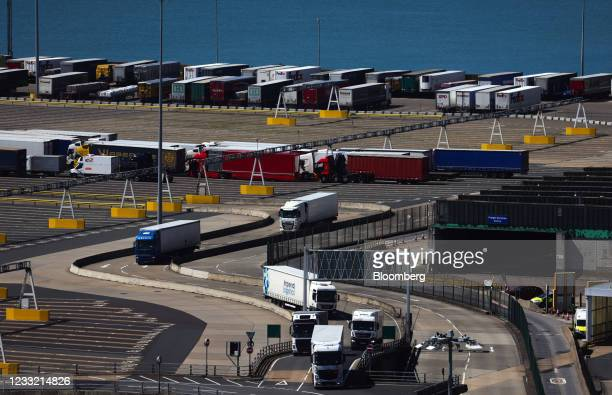 Haulage trucks pass cargo trailers after disembarking a from a ferry at the Port of Dover Ltd. In Dover, U.K., on Tuesday, June 1, 2021. Almost a...