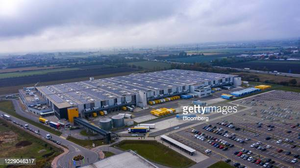Haulage trucks sit at loading bays at an Amazon.com Inc. Fulfillment center in this aerial photograph in Frankenthal, Germany, on Tuesday, Oct. 13,...
