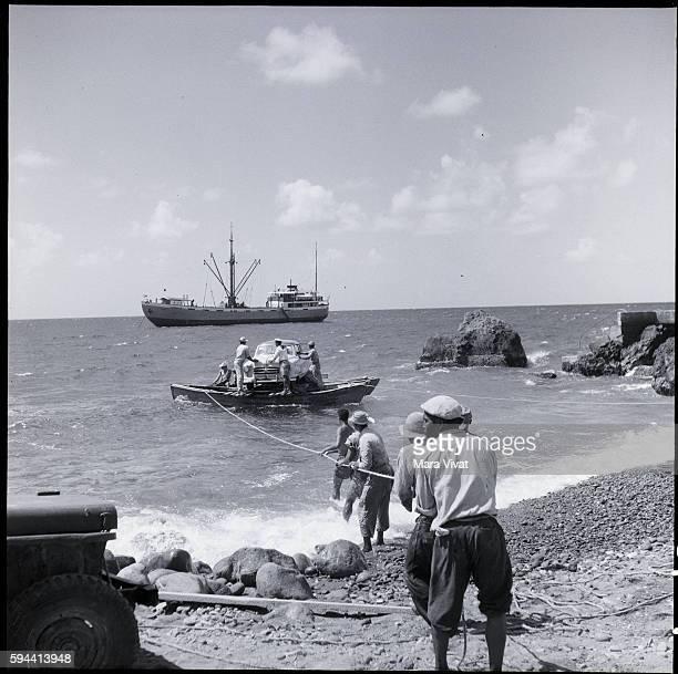 Hauling in Automobile on Raft Saba