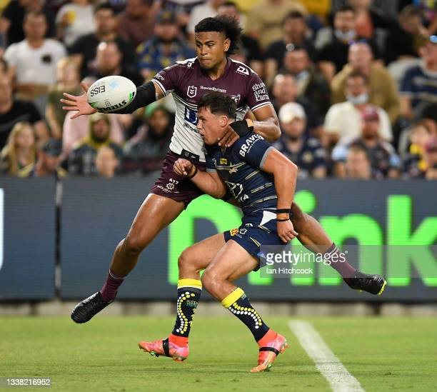 Haumole Olakau'atu of the Sea Eagles knocks the ball so Jake Trbojevic can score a try during the round 25 NRL match between the North Queensland...