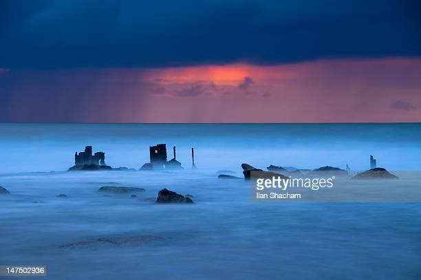 Haunting looking sea and wrecks at sunset