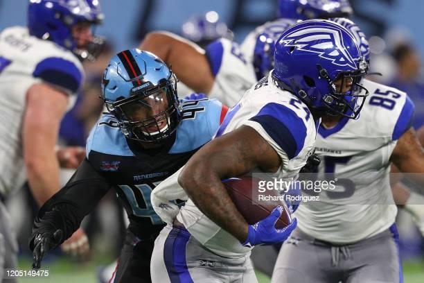 Hau'oli Kikaha of the Dallas Renegades tries to stop the run by Matt Jones of the St Louis Battlehawks in the fourth quarter at an XFL Game on...