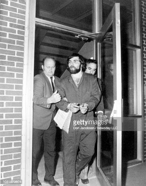Ronald DeFeo is led from the Suffolk County Police Headquarter on November 14 1974 in Hauppauge New York after being booked for six counts of...