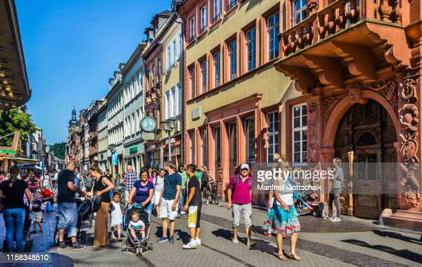 hauptstraße heidelberg, a popular shopping and pedestrian street traversing heidelberg's old town, baden-württemberg, germany, july 7, 2016 - hauptstraße stock pictures, royalty-free photos & images