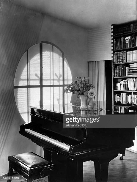 'Haus Baensch' Weinmeisterhöhe in BerlinSpandau view into a room with grand piano and 'moon window' architect Professor Hans Scharoun photograph...