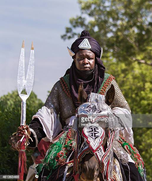 Hausa man riding a decorated horse at a Durbar Festival in Katsina, Katsina State, Nigeria.