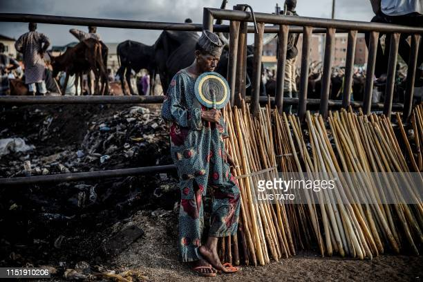 A HausaFulani man selling herdsmen's sticks waits for costumers at Kara Cattle Market in Lagos Nigeria on April 10 2019 Kara cattle market in Agege...