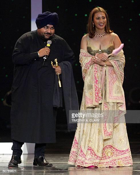 Haute Couture Designer of the Year JJ Vallaya recieves his award from presenter Mira Gandhi during the 2004 Bollywood Fashion Awards at the Trump Taj...