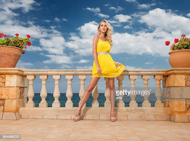 haute couture fashion, summer dress - long bright yellow dress stock pictures, royalty-free photos & images