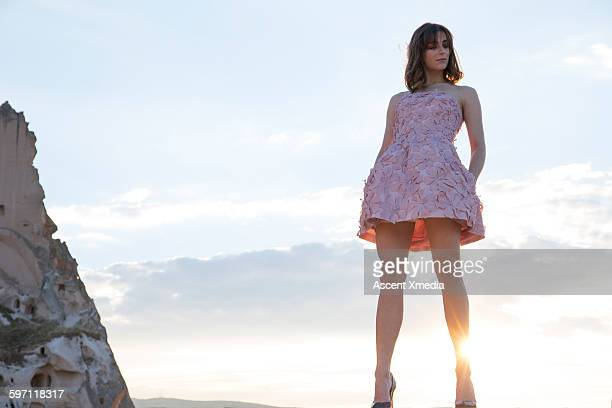 Haute couture model looks down from lofty perch