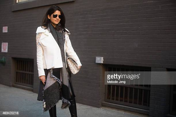 Haute Inhabit blogger Lainy Hedaya wears a Berardi jacket Khirma New York bag and Schutz shoes on the Streets of Manhattan on February 13 2015 in New...