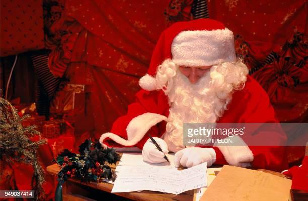 Mulhouse Christmas market Santa Claus writing letters HautRhin Mulhouse marché de Noël Père Noël répondant au courrier