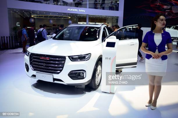 A Haval H4 car is displayed at the Beijing auto show on April 25 2018 Global carmakers touted their latest electric and SUV models in Beijing as they...