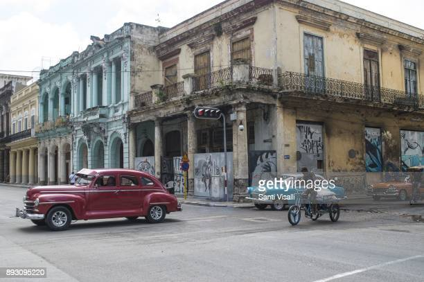 Havana architecture with vintage cars and bike on November 10 2017 in Havana Cuba
