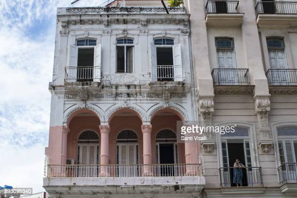 Havana architecture with woman on the balcony on November 10 2017 in Havana Cuba
