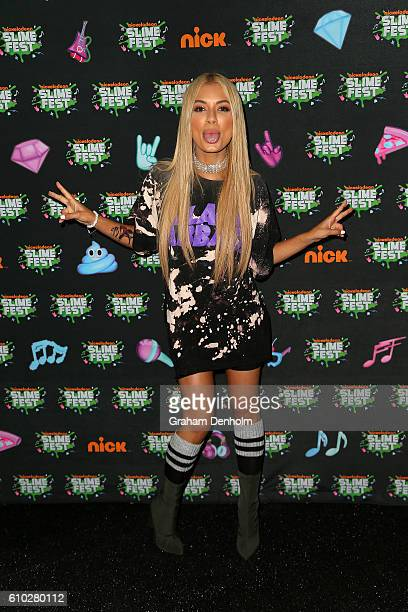Havana Brown poses on the media wall ahead of the Nickelodeon Slimefest 2016 evening show at Margaret Court Arena on September 25, 2016 in Melbourne,...
