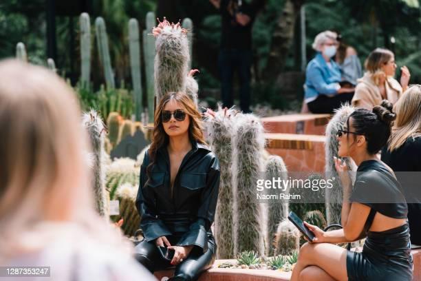 Havana Brown watches the Arid Garden Runway as part of Melbourne Fashion Week on November 24, 2020 in Melbourne, Australia.