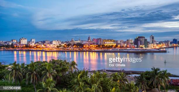 havana city by sea against sky during sunset. cuba - old havana stock pictures, royalty-free photos & images