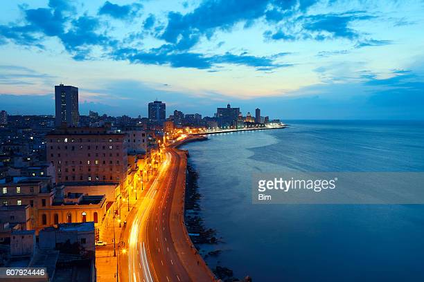 havana, cuba, malecon at dusk - old havana stock pictures, royalty-free photos & images