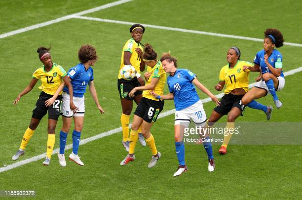 Havana Solaun of Jamaica competes for a header with Cristiana Girelli of Italy during the 2019 FIFA Women's World Cup France group C match between...