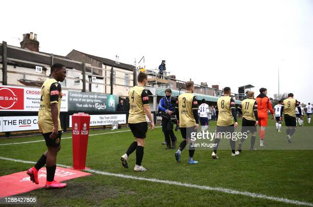 Havant and Waterlooville players enter the pitch ahead of the Emirates FA Cup Second Round match between Marine FC and Havant and Waterloovile at The...