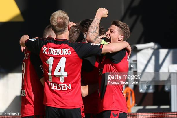 Havard Nielsen and Mike Frantz of Freiburg celebrate the goal of Pascal Stenzel of Freiburg during the Bundesliga match between SC Freiburg and Bayer...