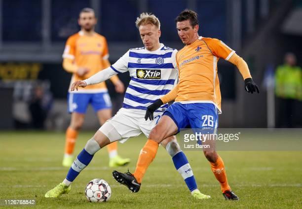 Havard Nielsen of Duisburg challenges Christoph Moritz of Darmstadt during the Second Bundesliga match between MSV Duisburg and SV Darmstadt 98 at...
