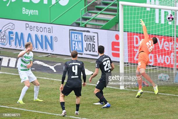 Havard Nielsen of SpVgg Greuther Furth scores their side's first goal past Christain Mathenia of 1.FC Nurnberg during the Second Bundesliga match...