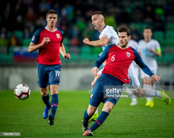 Havard Nordtveit Markus Henriksen of Norway Andraz Sporar of Slovenia during the UEFA Nations League C group three match between Slovenia and Norway...