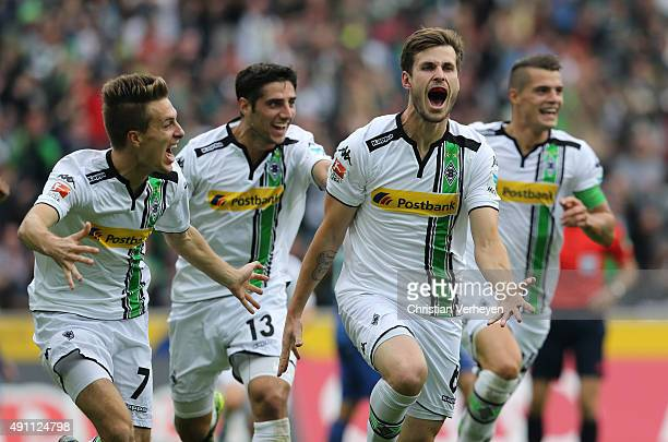 Havard Nordtveit of Borussia Moenchengladbach celebratea with his team mates after scoring their first goal during the Bundesliga match between...