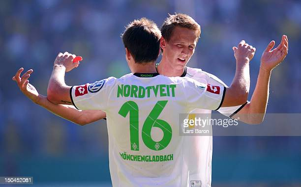 Havard Nordtveit of Moenchengladbach celebrates with team mate Luuk de Jong after scoring his teams second goal during the first round match of the...