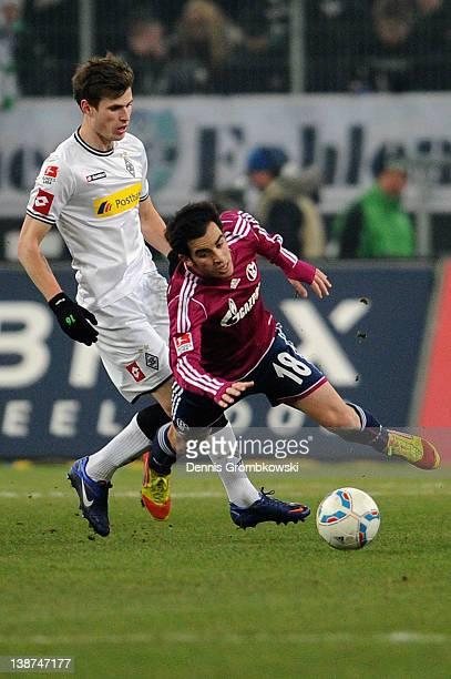 Havard Nordtveit of Moenchengladbach challenges Jurado of Schalke during the Bundesliga match between Borussia Moenchengladbach and FC Schalke 04 at...