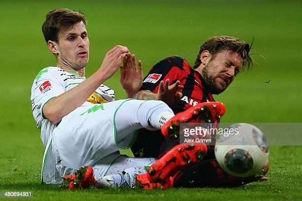 Havard Nordtveit of Moenchengladbach is challenged by Marco Russ of Frankfurt during the Bundesliga match between Eintracht Frankfurt and Borussia...