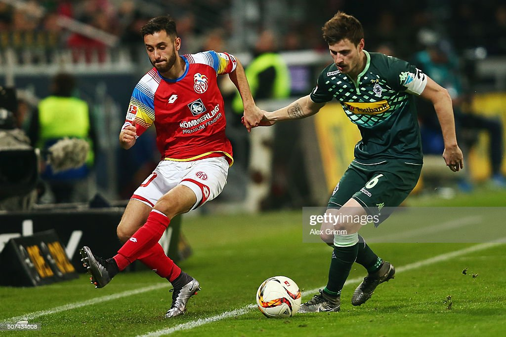 Havard Nordtveit (R) of Moenchengladbach is challenged by Yunus Malli of Mainz during the Bundesliga match between 1. FSV Mainz 05 and Borussia Moenchengladbach at Coface Arena on January 29, 2016 in Mainz, Germany.