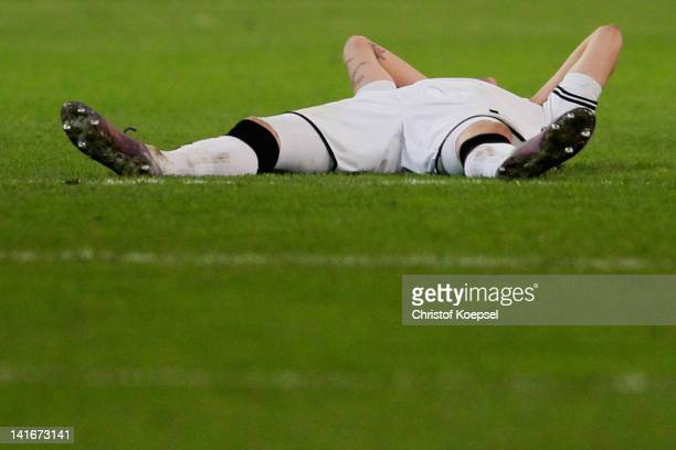 Havard Nordtveit of Moenchengladbach lies dejected on the pitch after losing 2-4 after penalty shoot-out the DFB Cup semi final match between...