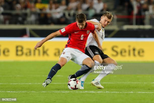 Havard Nordtveit of Norway and Toni Kroos of Germany battle for the ball during the FIFA 2018 World Cup Qualifier between Germany and Norway at...