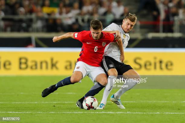 Havard Nordtveit of Norway und Toni Kroos of Germany battle for the ball during the FIFA 2018 World Cup Qualifier between Germany and Norway at...
