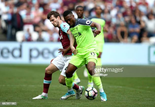 Havard Nordtveit of West Ham United and Daniel Sturridge of Liverpool compete for the ball during the Premier League match between West Ham United...