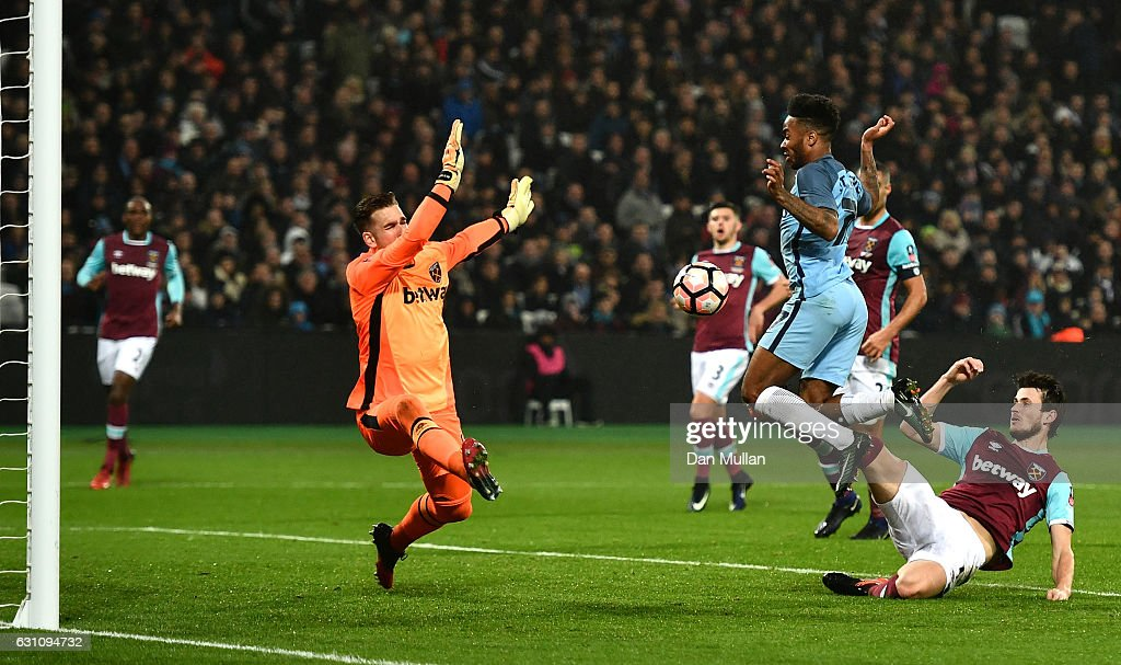 Havard Nordtveit of West Ham United scores an own goal which after he is put under pressure from Raheem Sterling of Manchester City during The Emirates FA Cup Third Round match between West Ham United and Manchester City at London Stadium on January 6, 2017 in London, England.