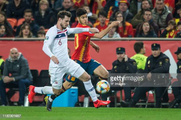 Havard Nordveit of Norway and Marco Asensio of Spain battle for the ball during the 2020 UEFA European Championships group F qualifying match between...