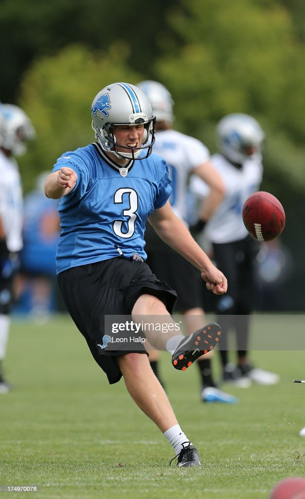 Havard Rugland #3 of the Detroit Lions goes through the kicking drills during training camp on July 29, 2013 in Allen Park, Michigan.