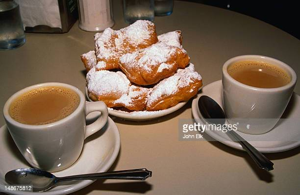 Have a cafe au lait with a light beignet at the famous Cafe Du Monde - The Original Coffee Stand, French Quarter 'Vieux Carre', New Orleans
