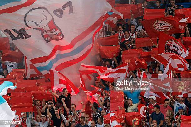 PSV have cheer prior to the UEFA Champions League Playoff First Leg match between PSV Eindhoven and AC Milan at PSV Stadion on August 20 2013 in...