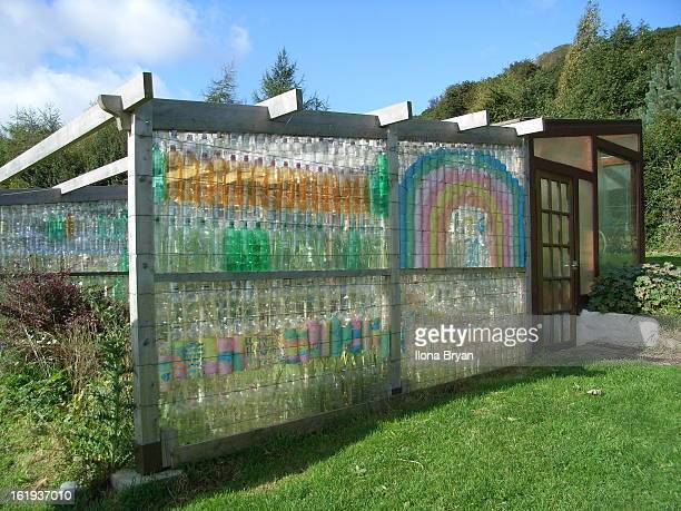Have done a lot of strange things with recycling plastic drinks bottles, but why did I never think of building walls? These were used to screen off a...